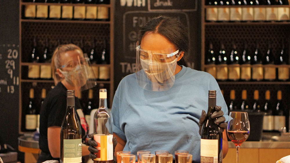 Women wearing coronavirus face masks while working | Out and About Supply