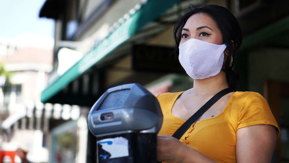 Women wearing white antiviral face mask | Out and About Supply